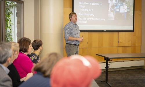 Guest Speaker Colby King talks with faculty and staff about supporting first-generation working class students. alt