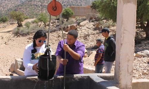 WPI students check a greywater recycling system, part of a fog harvesting initiative in Morocco. alt
