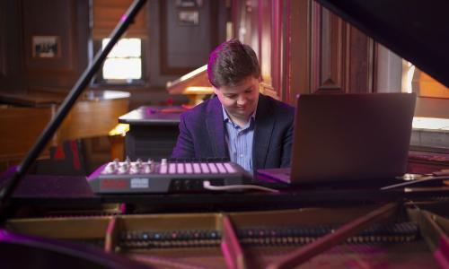 David Ibbett at the piano, playing Water Romanza. alt