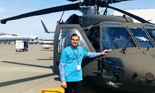 Abdullah with Boeing aircraft during his internship with the company. alt