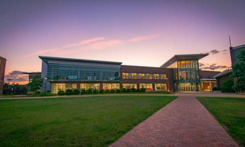 A photo of the Sports & Recreation Center at sunset.
