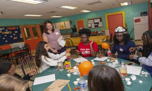 "Students in the TPP work with local organizations such as Girls Inc. to develop lessons that sometimes take shape as a fun community activity, like ""Spooky Science,"" pictured here. alt"