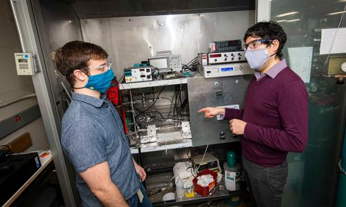 WPI professor Andrew Teixeira (right) confers with PhD student Cameron Armstrong, who custom built an ultrafast micro catalytic reactor to produce ammonia. alt